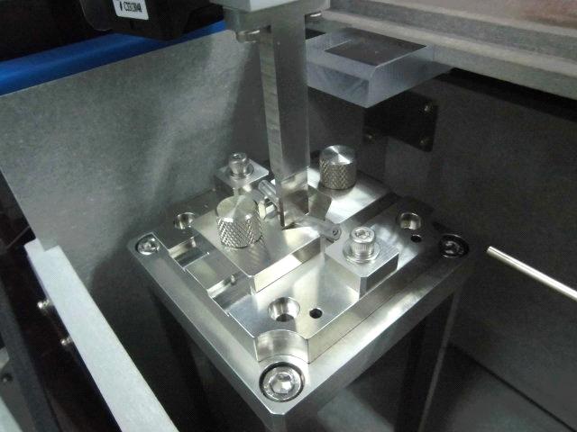 チューブの押し付け戻り力測定装置